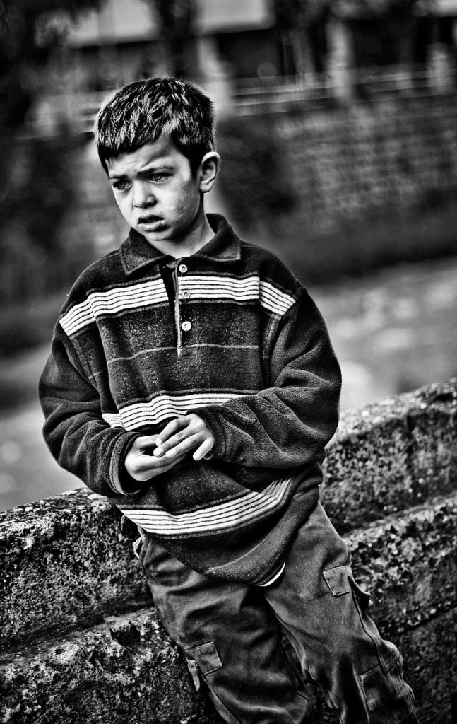 The poverty rate for US children is the highest in the Western World. Pictured is a child in poverty.