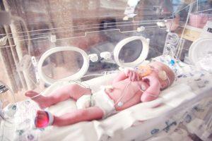 baby in incubator NICU