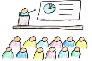 A cartoon picture of a stick figure showing a chart to an audience.