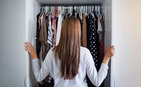 Girl looking in closet