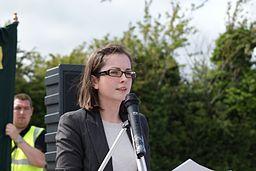 Speaker standing behind a microphone