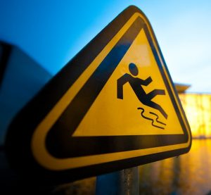A sign of a person slipping