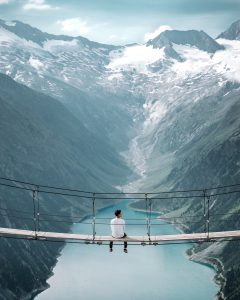 Picture of a person sitting on a bridge