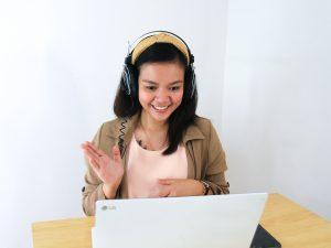 Woman talking to computer camera