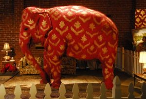An elephant standing in a room