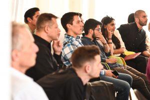 An audience listening to a speech