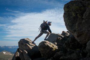 A man climbing on rocks