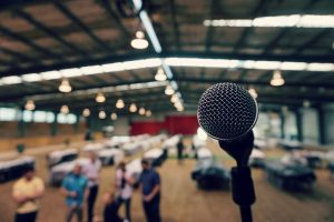 Microphone and empty speaking venue