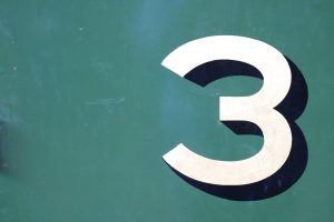 The number three painted on a wall