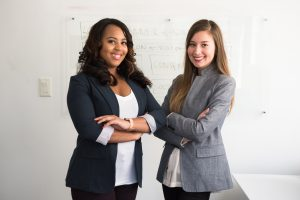 Two women professionally dressed