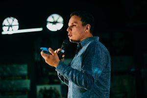 Man holding microphone speaking