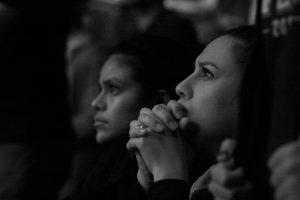 An audience member listening to a speech