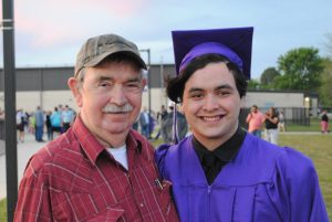 A picture of a graduate and his grandfather